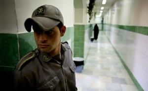 A prison guard stands along a corridor in Tehran's Evin prison June 13, 2006. Iranian police detaine..