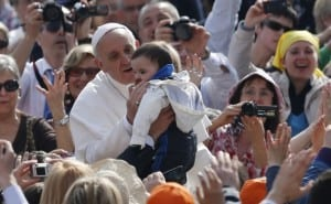 Pope greets baby as he arrives to lead general audience at Vatican