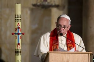 Pope Francis talks during a meeting at the Church of Gethsemane in Jerusalem