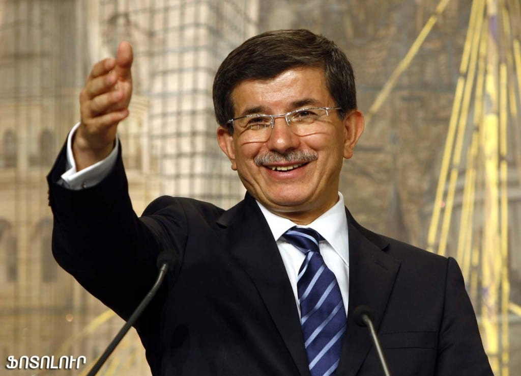 Turkey's Foreign Minister Davutoglu talks during a joint news conference with his Syrian counterpart Moualem in Istanbul