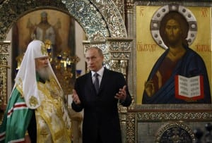 Russian President Putin speaks to Russian Orthodox Patriarch Alexiy II during visit to Iversky Monastery