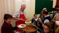 Bishop Bizzeti distributes pasta to the community with his own hands